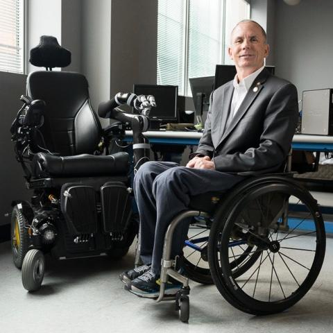Dr Rory Cooper pictured next to the wheelchair he designed
